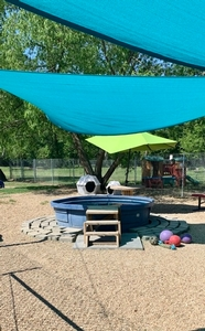 Play Yard with sunsails and willow trees for shade